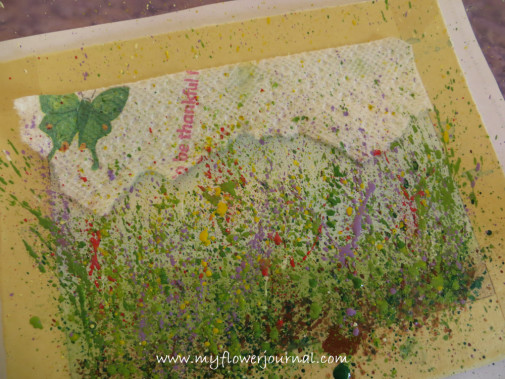 Use a paper towel to cover parts of painting you don't want splattered for your splattered flower garden painting-myflowerjournal.com